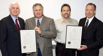 The CAN DO Community Foundation presented electricians with a resolution recognizing their efforts in restoring the Ferrwood Music Camp. From left: CAN DO President Kevin O'Donnell; Robert Judd, president of Arc Electric Construction Co.; John T. Nadolny, training director for International Brotherhood of Electrical Workers Local 163;  and CAN DO Community Foundation President Gary F. Lamont.